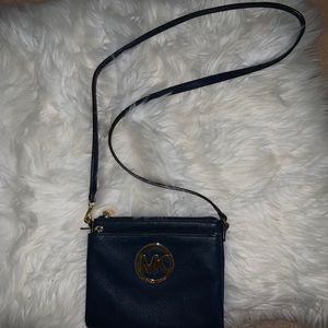 A navy blue cross body bag!
